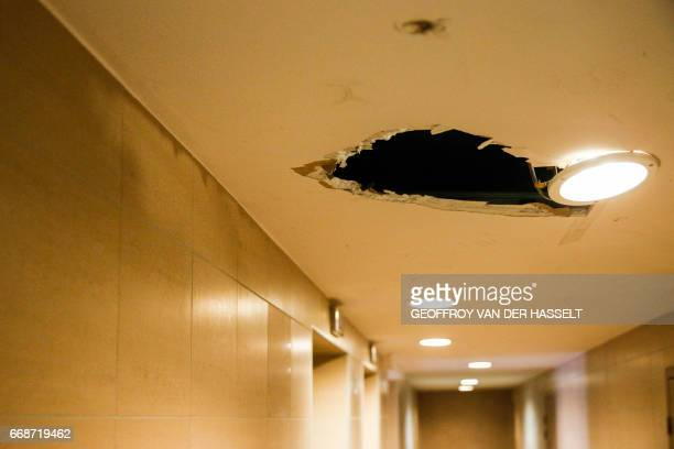 A hole is seen in the ceiling inside an HLM building that is part of the HLM housing estate of AulnaysousBois a commune in the SeineSaintDenis...