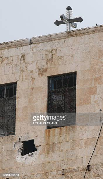 A hole iseen in a wall of the Sednaya Monastery during a guided government tour for journalists to view damage caused to the convent in a recent...