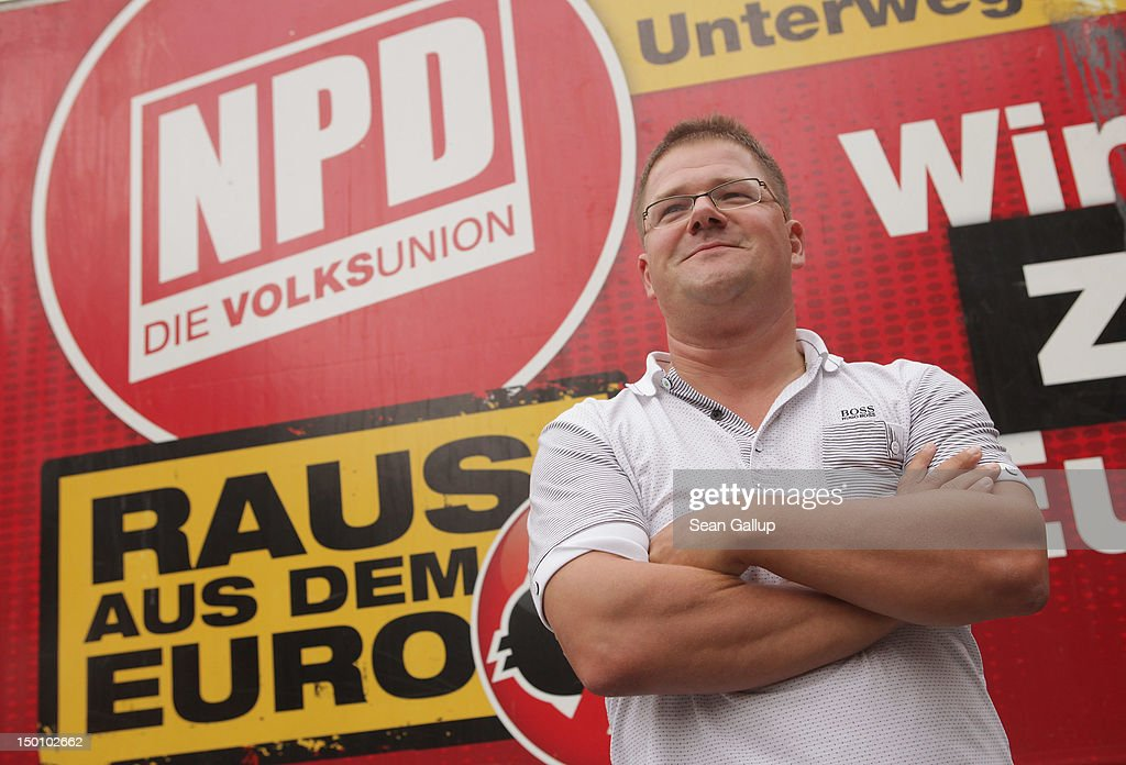 Holger Apfel, Chairman of the far-right-wing NPD political party, speaks at a small rally in Tegel district on August 10, 2012 in Berlin, Germany. The NPD has toured cities across northern Germany over the summer and today's stop in Berlin was the last.
