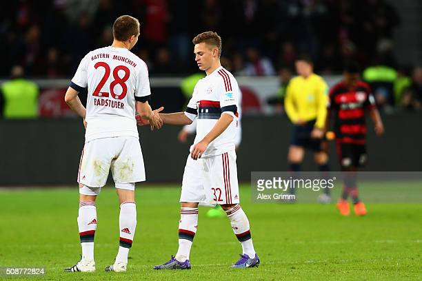 Holger Badstuber and Joshua Kimmich of Muenchen shake hands after the Bundesliga match between Bayer Leverkusen and FC Bayern Muenchen at BayArena on...