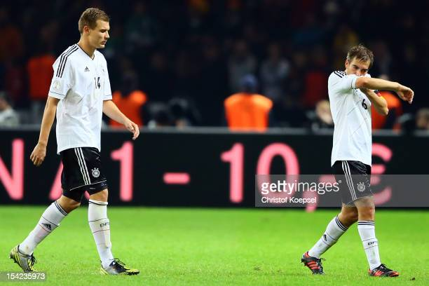 Holger Badstuber and Philipp Lahm of Germany look dejected after the 44 draw of the FIFA 2014 World Cup qualifier group C match between German and...