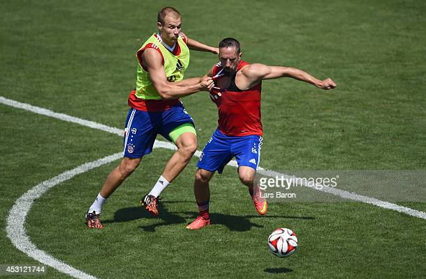 Holger Badstuber challenges Franck Ribery during a Bayern Muenchen training session at day five of the Audi Summer Tour USA 2014 at Portland...