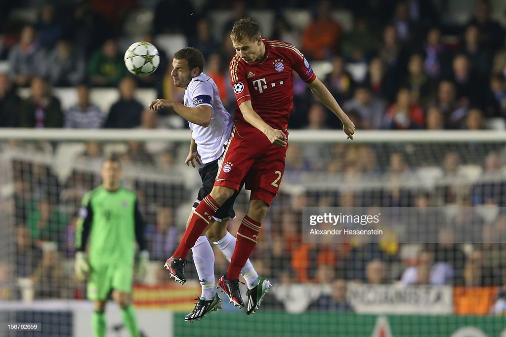 Holger Badstuber (R) of Bayern Muenchen battles for the ball with Roberto Sodado of Valencia during the UEFA Champions League group F match between Valencia FC and FC Bayern Muenchen at Estadio Mestalla on November 20, 2012 in Valencia, Spain.