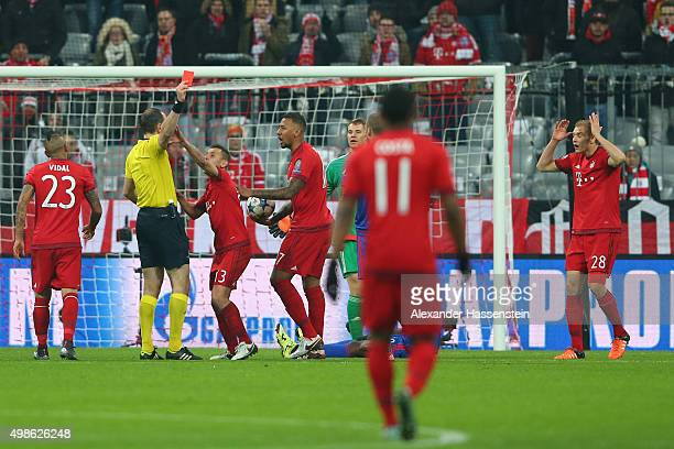 Holger Badstuber of Bayern Muenchen is shown the red card by referee Jonas Eriksson during the UEFA Champions League group F match between FC Bayern...
