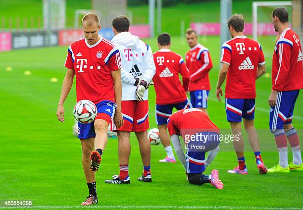 Holger Badstuber of Muenchen in action during a training session of FC Bayern Muenchen on August 20 2014 in Munich Germany