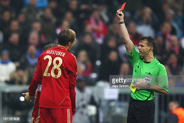 Holger Badstuber of Muenchen is sent off by referee Bjoern Kuipers during the UEFA Champions League group A match between FC Bayern Muenchen and SSC...