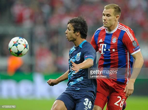 Holger Badstuber of Munich challenges Oliver Torres of Porto during the UEFA Champions League quarter final second leg match between FC Bayern...