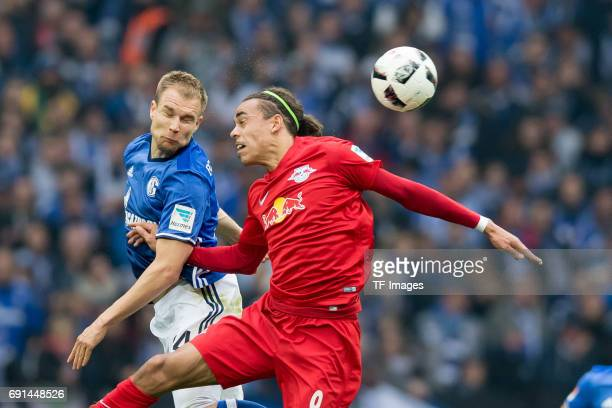 Holger Badstuber of Schalke and Yussuf Poulsen of Leipzig battle for the ball during the Bundesliga match between FC Schalke 04 and RB Leipzig at...