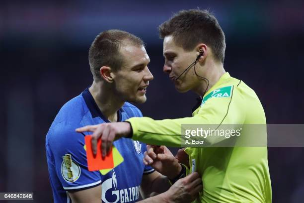 Holger Badstuber of Schalke is sent off by referee Daniel Siebert during the DFB Cup quarter final between Bayern Muenchen and FC Schalke 04 at...