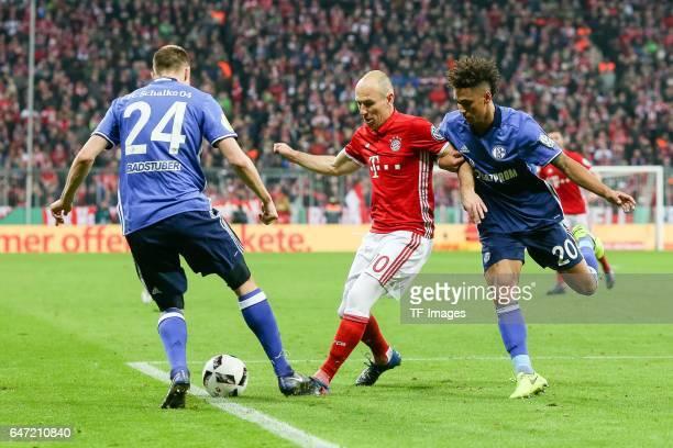 Holger Badstuber of Schalke Thilo Kehrer of Schalke and Arjen Robben of Bayern Muenchen battle for the ball during the DFB Cup quarter final between...