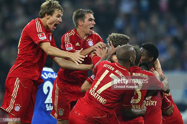 Holger Badstuber Philipp Lahm Jérome Boateng Thomas Mueller who scored the second goal and David Alaba of Bayern celebrate the second goal during the...