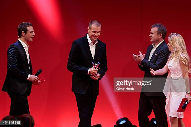 Holger Badstuber poses with the Award during the Sport Bild Awards at Fischauktionshalle on August 25 2014 in Hamburg Germany