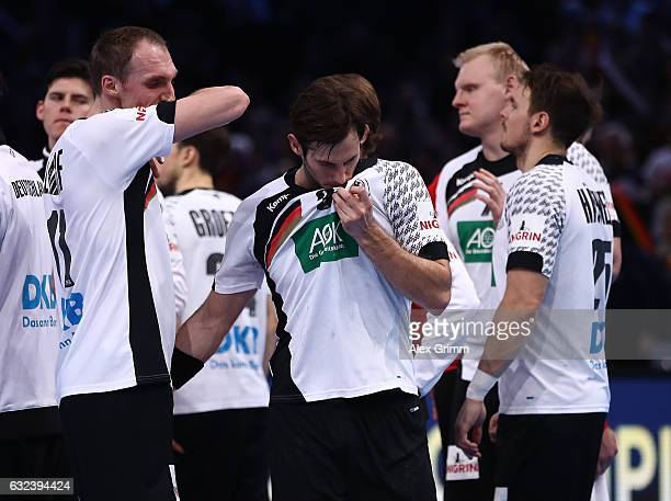 Holger Glandorf and Uwe Gensheimer of Germany look dejected after the 25th IHF Men's World Championship 2017 Round of 16 match between Germany and...