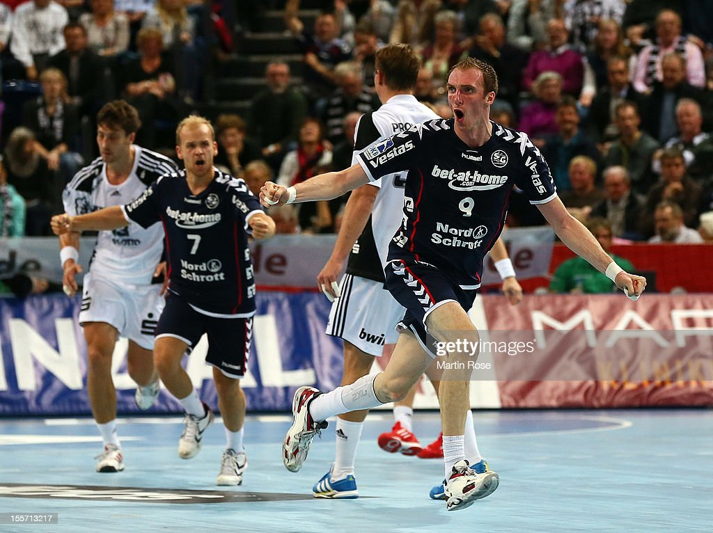 <a gi-track='captionPersonalityLinkClicked' href=/galleries/search?phrase=Holger+Glandorf&family=editorial&specificpeople=687256 ng-click='$event.stopPropagation()'>Holger Glandorf</a> of Flensburg celebrates after scoring during the DKB Handball Bundesliga match between THW Kiel and SG Flensburg-Handewitt at Sparkassen Arena on November 7, 2012 in Kiel, Germany.