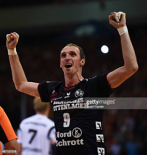 Holger Glandorf of Flensburg celebrates scoring during the DKB Handball Bundeslga match between SG FlensburgHandewitt and THW Kiel at FlensArena on...