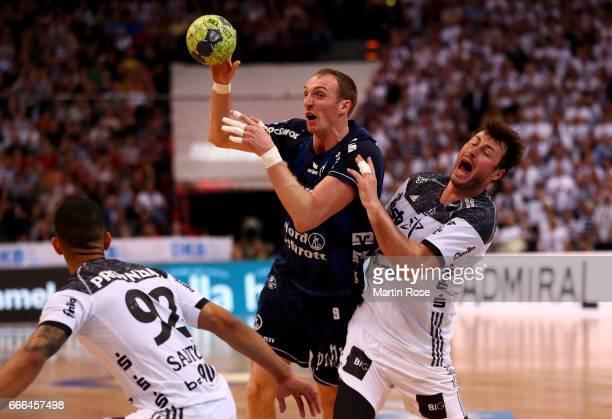 Holger Glandorf of Flensburg challenges Domagoj Duvnjak of Kiel for the ball during the Rewe Final Four final match between SG FlensburgHandewitt and...