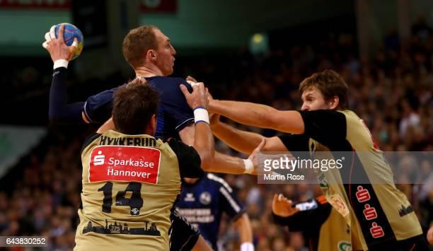 Holger Glandorf of Flensburg challenges Fabian Boehm of HannoverBurgdorf for the ball during the DKB HBL Bundesliga match between SG...