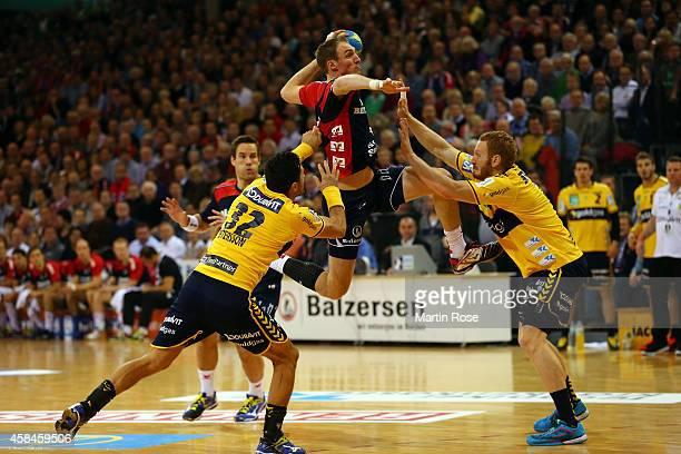 Holger Glandorf of Flensburg challenges for the ball with Alex Petersson of Rhein Neckar Loewen during the Bundesliga handball match between...