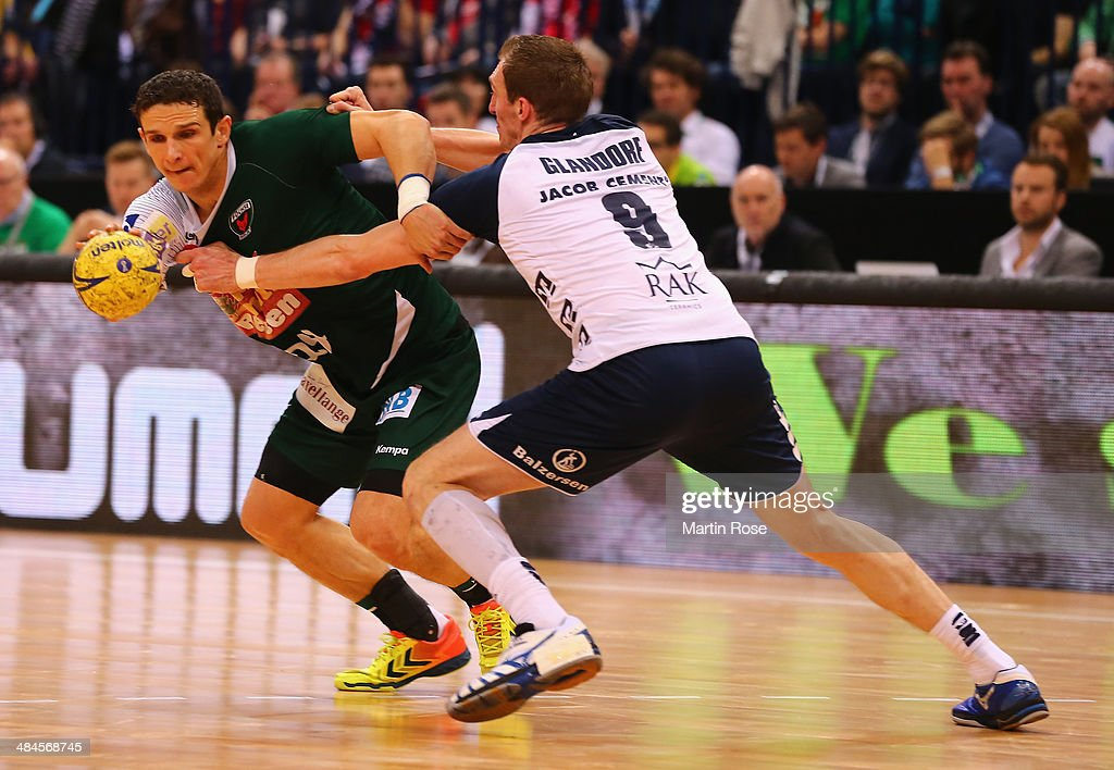 Holger Glandorf (R) of Flensburg challenges for the ball with <a gi-track='captionPersonalityLinkClicked' href=/galleries/search?phrase=Bartlomiej+Jaszka&family=editorial&specificpeople=4838990 ng-click='$event.stopPropagation()'>Bartlomiej Jaszka</a> (L) of Berlin during the DHB Pokal handball final match between Flensburg Handewitt and Fuechse Berlin at O2 World on April 13, 2014 in Hamburg, Germany.