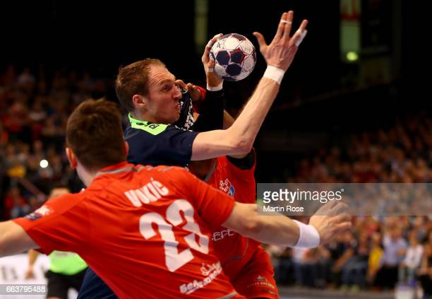 Holger Glandorf of Flensburg Handewitt challenges Ljubo Vukic of Brest HC Meshkov for the ball during the Velux EHF Champions League round of 16...