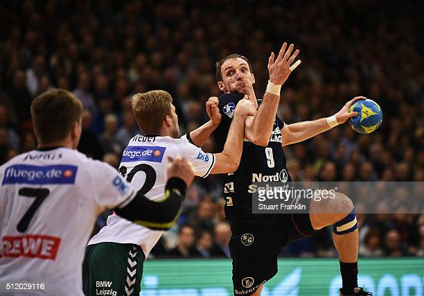 Holger Glandorf of Flensburg is challenged by Philipp Weber of Leipzig during the DKB Bundesliga handball match between SG Flensburg Handewitt and SC...
