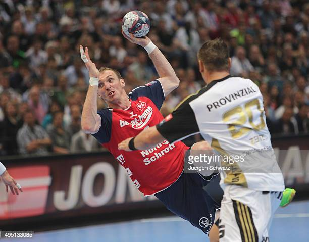 Holger Glandorf of Flensburg throws the ball near Christian Zeitz of Kiel during the EHF Champions League Final between SG FlensburgHandewitt and THW...