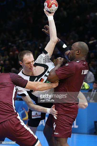 Holger Glandorf of Germany and Hassan Mabrouk of Qatar in action during the 25th IHF Men's World Championship 2017 Round of 16 match between Germany...