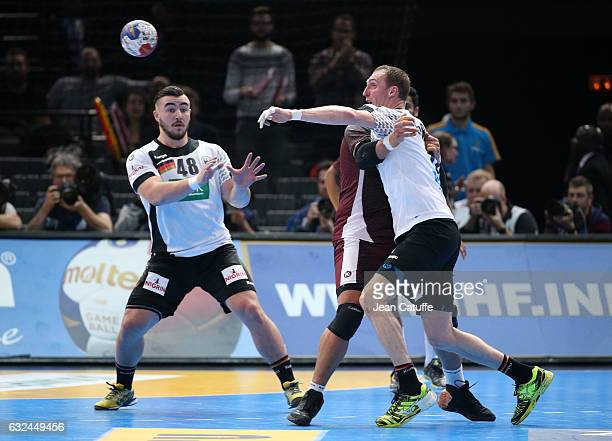 Holger Glandorf of Germany and teammate Jannick Kohlbacher in action during the 25th IHF Men's World Championship 2017 Round of 16 match between...