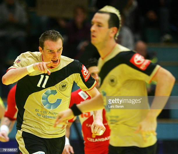 Holger Glandorf of Germany celebrates scoring a goal next to team mate Henning Fritz during the Men's Handball European Championship main round Group...
