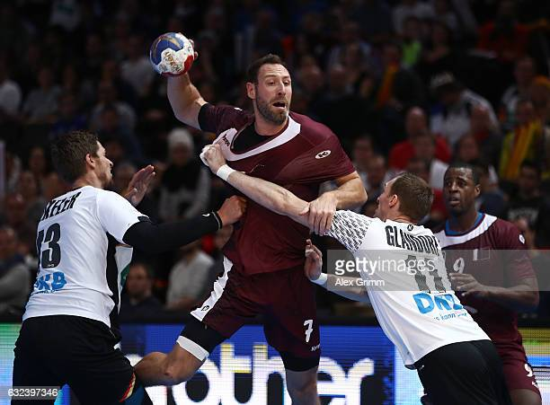 Holger Glandorf of Germany challenges Bertrand Roine of Qatar during the 25th IHF Men's World Championship 2017 Round of 16 match between Germany and...