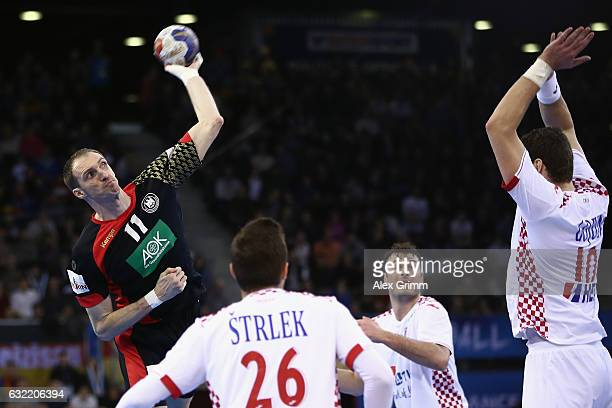 Holger Glandorf of Germany is challenged by Jakov Gojun of Croatia during the 25th IHF Men's World Championship 2017 match between Germany and...
