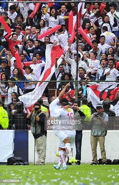 Holger Matamoros of Ecuador's Liga de Quito celebrates with Diego Morales after scoring against Paraguay's Nacional during their Copa Sudamericana...
