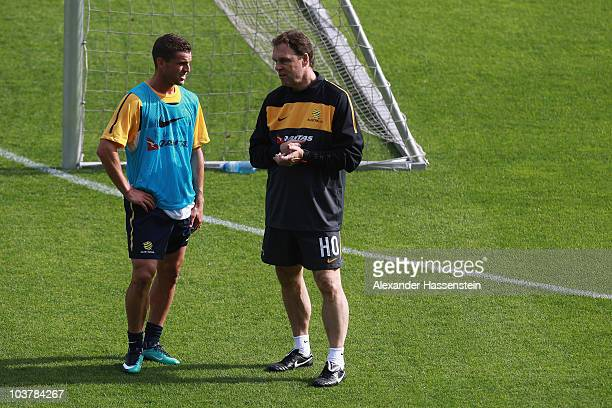 Holger Osieck head coach of team Australia talks to his player Jason Culina during an Australian Socceroos training session at the AFG Arena on...