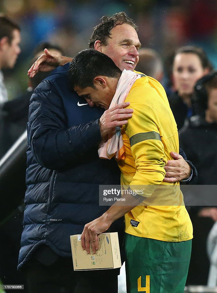 <a gi-track='captionPersonalityLinkClicked' href=/galleries/search?phrase=Holger+Osieck&family=editorial&specificpeople=579862 ng-click='$event.stopPropagation()'>Holger Osieck</a>, head coach of the Socceroos and <a gi-track='captionPersonalityLinkClicked' href=/galleries/search?phrase=Tim+Cahill+-+Soccer+Player&family=editorial&specificpeople=209085 ng-click='$event.stopPropagation()'>Tim Cahill</a> of the Socceroos celebrate after the FIFA 2014 World Cup Asian Qualifier match between the Australian Socceroos and Iraq at ANZ Stadium on June 18, 2013 in Sydney, Australia.
