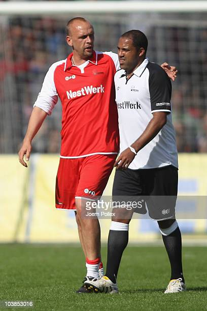 Holger Stanislawski of the team Hamburgtalks to Ailton Hamburg of the team Germany during the Day of Legends match between team Germany and the rest...
