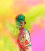 Close-up of a young boy playing Holi in India.