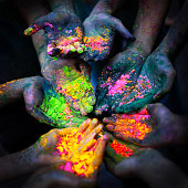 Color powder on hands during Holi Festival