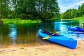 Canoe on the shore of the Krutynia river in Masuria land, Poland
