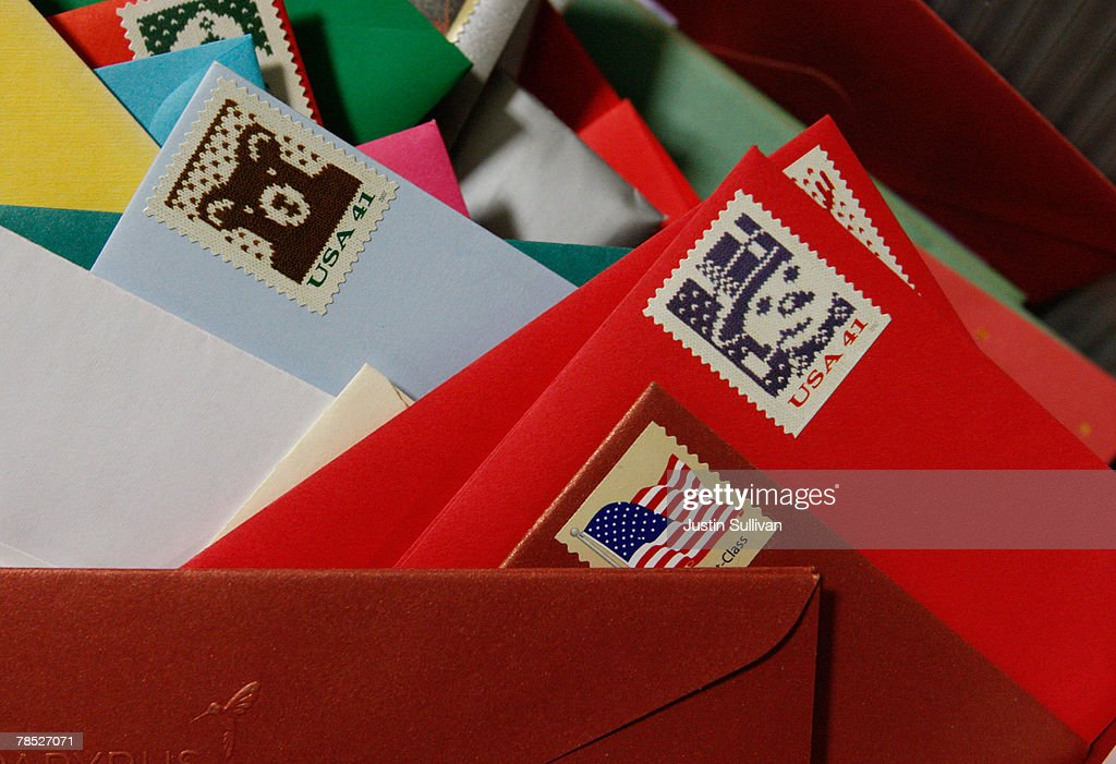 Holiday cards sit in a bin at the US Post Office December 17 2007 in San Francisco California With one week until Christmas the US Postal Service is...