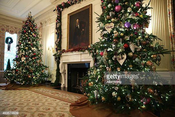 Holiday decorations are displayed in the State Dining Room of the White House during an event to preview the 2013 holiday decorations December 4 2013...