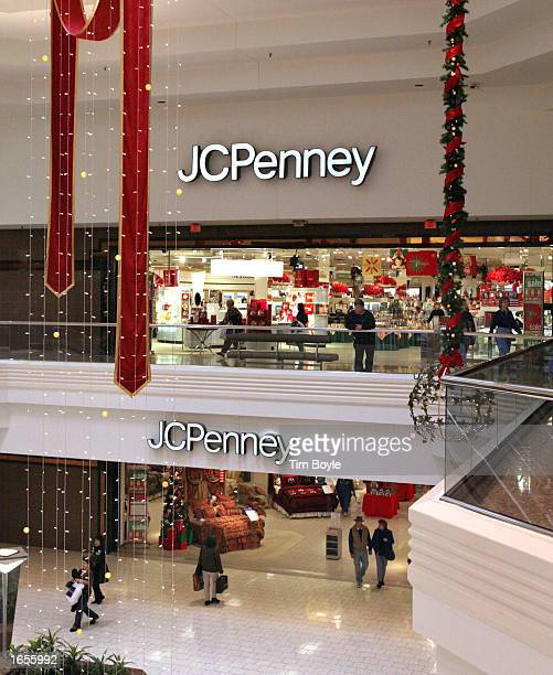 Holiday decorations hang near an entrance to the JC Penney store at Woodfield Mall November 22 2002 in Schaumburg Illinois JC Penney Company Inc has...