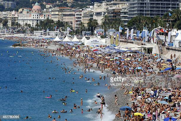 Holiday goers sunbathe on the beach in Nice southeastern France on July 27 2014 AFP PHOTO / VALERY HACHE