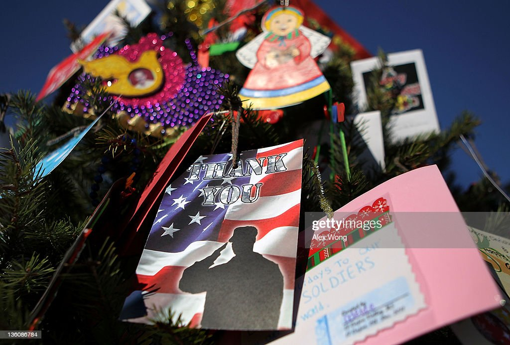Holiday greeting cards and ornaments hang on a Christmas tree at the Vietnam Veterans Memorial December 19, 2011 in Washington, DC. The Vietnam Veterans Memorial Fund (VVMF) honored veterans and active-duty military personnel during its annual Christmas tree ceremony by placing the tree, decorated with homemade holiday greeting cards and ornaments sent by Americans, near the wall of the memorial.