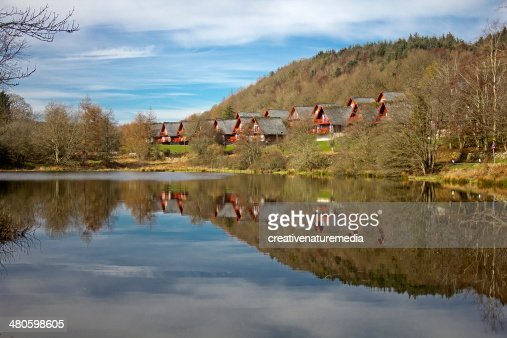 Holiday Lodges Reflected in Loch : Stock Photo