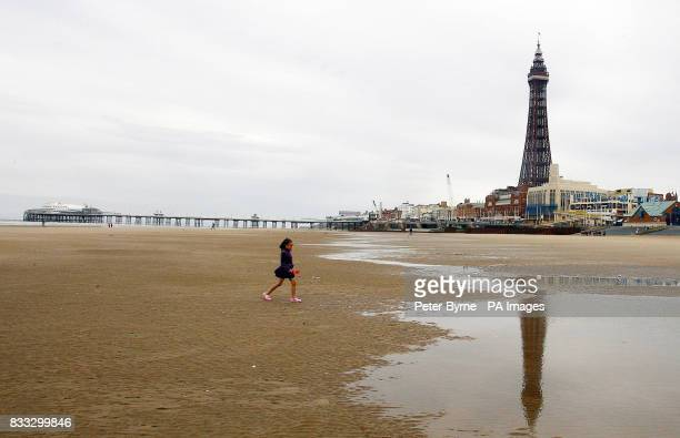 A holiday maker enjoys Blackpool beach as most of Britain experiences warm weather