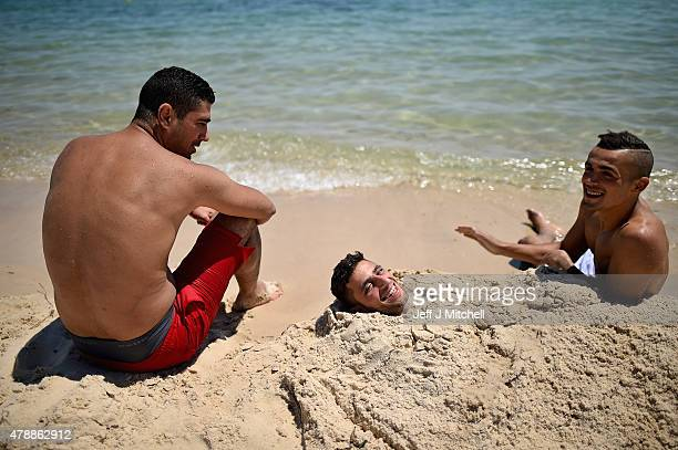 Holiday makers continue their vacations at Marhaba beach near to where 38 people were killed on Friday in a terrorist attack on June 28 2015 in...