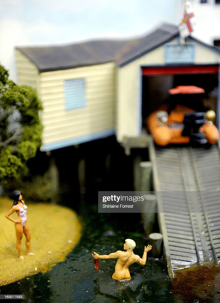 Holiday makers in a model village at the Northern Modelling Exhibition at EventCity on March 3, 2013 in Manchester, England.