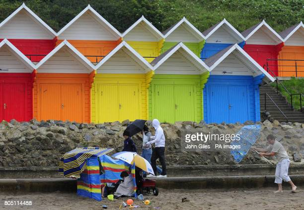 Holiday makers in heavy rain and strong winds on Scarborough beach The Met Office had predicted a rainy August opposed to its earlier statement in...
