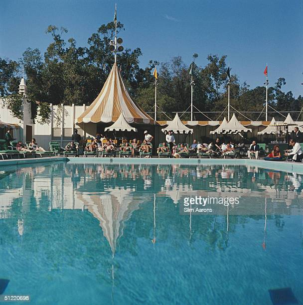 Holiday makers relaxing by the pool at the Beverly Hills Hotel on Sunset Boulevard in California 1957