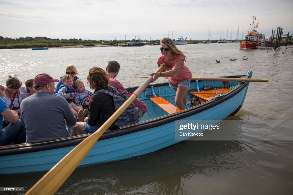 Holiday makers take the ferry to Southwold, which consists of a traditional rowing boat that has been run since 1885 by the same family for five generations, on August 11, 2017 in Walberswick, England. Much of the country is expected to enjoy a sunny spell over the weekend after a period of unseasonably wet weather.